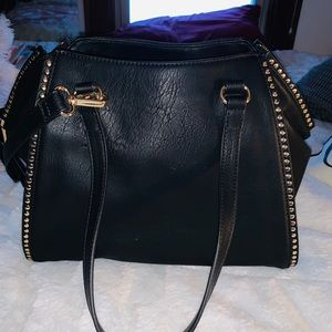 INC black purse with extended side strap